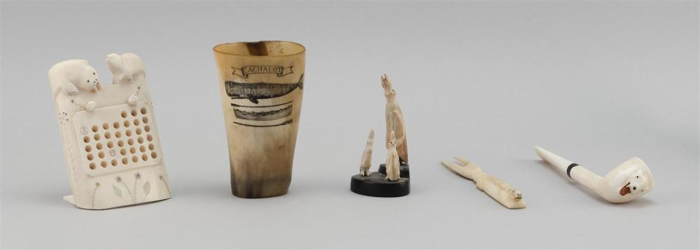 """FIVE ASSORTED ESKIMO ITEMS Includes a horn cup, and a walrus ivory serving fork, pipe, game and penguin carving. Lengths from 3.25""""..."""