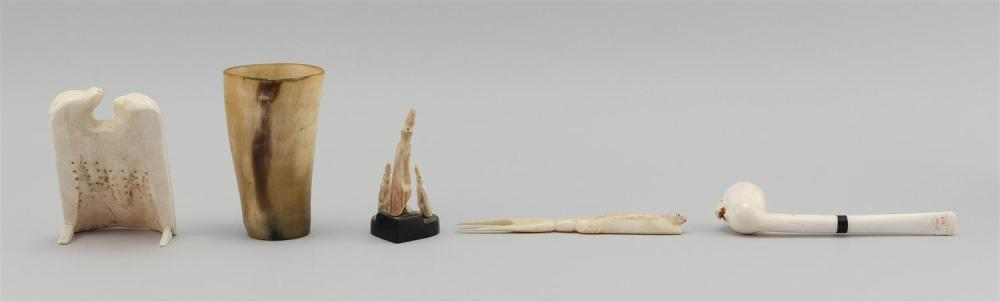FIVE ASSORTED ESKIMO ITEMS Includes a horn cup, and a walrus ivory serving fork, pipe, game and penguin carving. Lengths from 3.25