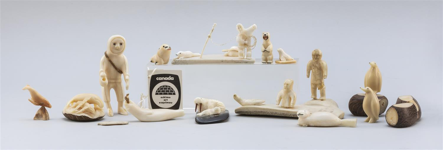 "THIRTEEN ESKIMO WALRUS IVORY AND NUT MINIATURE CARVINGS In the forms of assorted Arctic figures. Heights from .5"" to 3.5"". This item..."