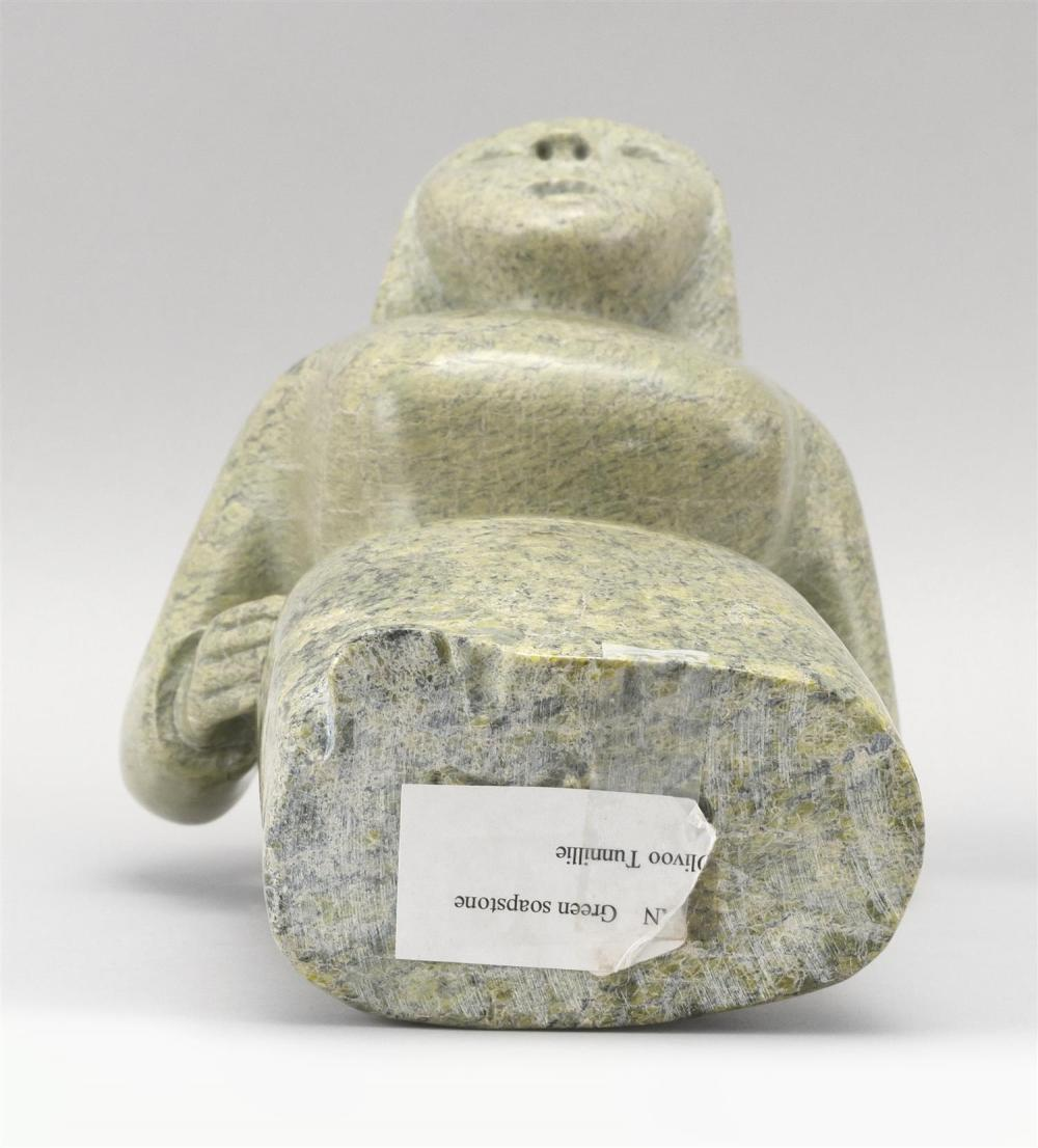 CAPE DORSET GREEN SOAPSTONE CARVING OF A FEMALE FIGURE Label on underside marked
