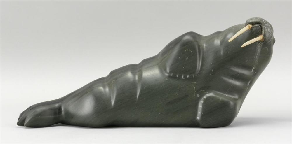 """GREEN SOAPSTONE CARVING OF A WALRUS With ivory tusks. Length 15.75"""". Proceeds to benefit Cape Symphony Orchestra. This item is not a..."""