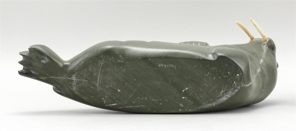GREEN SOAPSTONE CARVING OF A WALRUS With ivory tusks. Length 15.75
