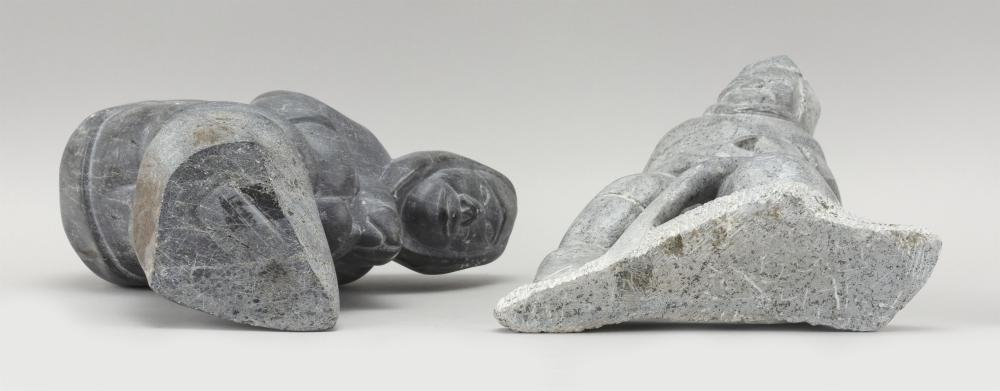 TWO ESKIMO GRAY SOAPSTONE FIGURAL CARVINGS An Eskimo cutting ice, height 9.5