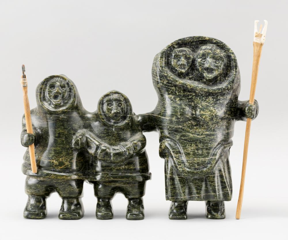 """GRAY SOAPSTONE CARVING OF AN ESKIMO FAMILY With a wood and ivory fish spear and boat hook. Signed and dated on underside """"Paul Kowma..."""