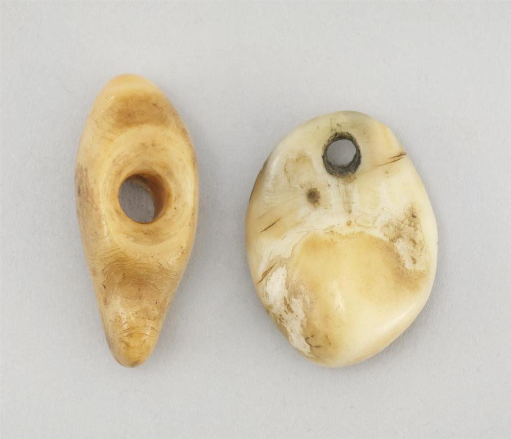 TWO ESKIMO CARVED BONE AMULETS One in teardrop shape. Other etched