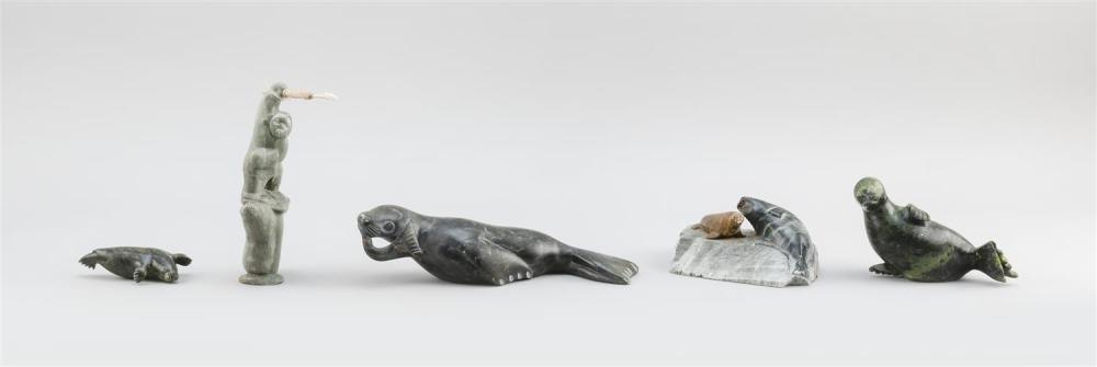 """FIVE ESKIMO STONE CARVINGS OF SEALS One of a seal with fish, length 9.5"""", one of two seals on a rock, length 5"""", two of reclining se..."""