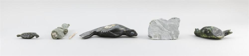 FIVE ESKIMO STONE CARVINGS OF SEALS One of a seal with fish, length 9.5