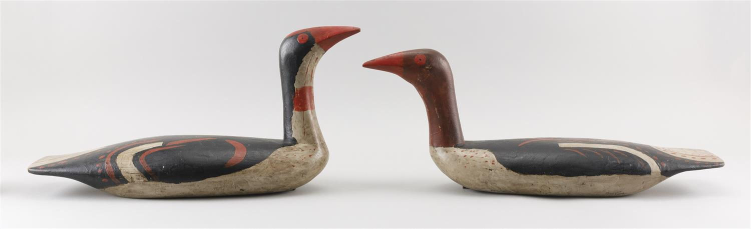 """PAIR OF NORTHWEST COASTAL-STYLE DECOYS BY BOB BIDDLE Original paint with minor wear. Lengths 20.5"""" and 21.5""""."""