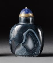 BLACK & WHITE FORTIFICATION AGATE SNUFF BOTTLE In ovoid form. Height 2.5