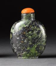 MOTTLED GREEN JADE SNUFF BOTTLE In spade shape. Height 2.5