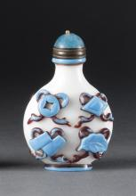 DOUBLE OVERLAY GLASS SNUFF BOTTLE In ovoid form with blue and red pahua design on a milk-white ground. Height 2.25