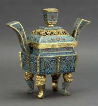 CLOISONNÉ ENAMEL CENSER In rectangular form with quadruped base and upswept handles. Body decorated with stylized mask and flower de...