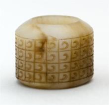 MUTTON-FAT JADE SCHOLAR'S RING With engraved comma design.