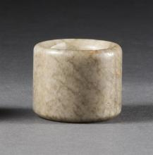 MUTTON-FAT JADE ARCHER'S RING In cylinder form with striations suggesting ge ware.