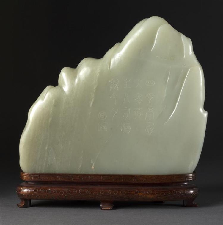 White and celadon jade mountain with relief carving of an el