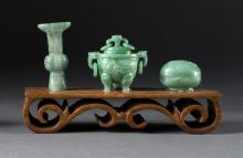 THREE MINIATURE GREEN JADEITE PIECES Covered koro with lion's-head and loose ring handles, length 1.75