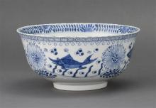 BLUE AND WHITE PORCELAIN BOWL With fish and lotus design. Diameter 8