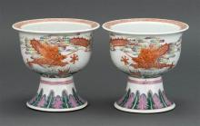 PAIR OF POLYCHROME PORCELAIN FOOTED BOWLS In bell form bowl on a flared foot. Decorated with an iron-red five-claw dragon creating w...