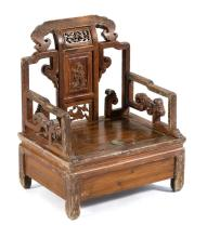 CARVED WOOD VENDOR'S CHAIR With carved back panel and ruyi carving on arms and crest. Lift seat. Height of seat 9.5