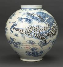 KOREAN UNDERGLAZE RED AND BLUE PORCELAIN JAR In ovoid form with four-claw dragon and cloud design. Height 16.25
