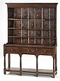 ANTIQUE WELSH CUPBOARD Shallow upper section with open shelves. Lower section with three drawers over open shelf. Height 71½