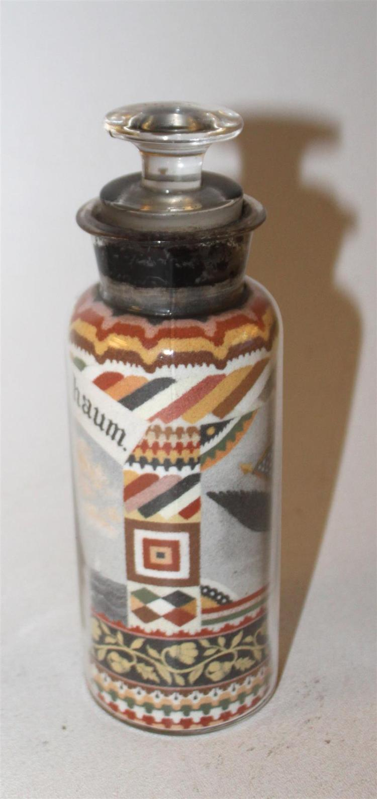 ANDREW CLEMENS SAND ART BOTTLE Multicolored sand arranged in a clear glass wax-sealed apothecary bottle. Striated borders spanning t...