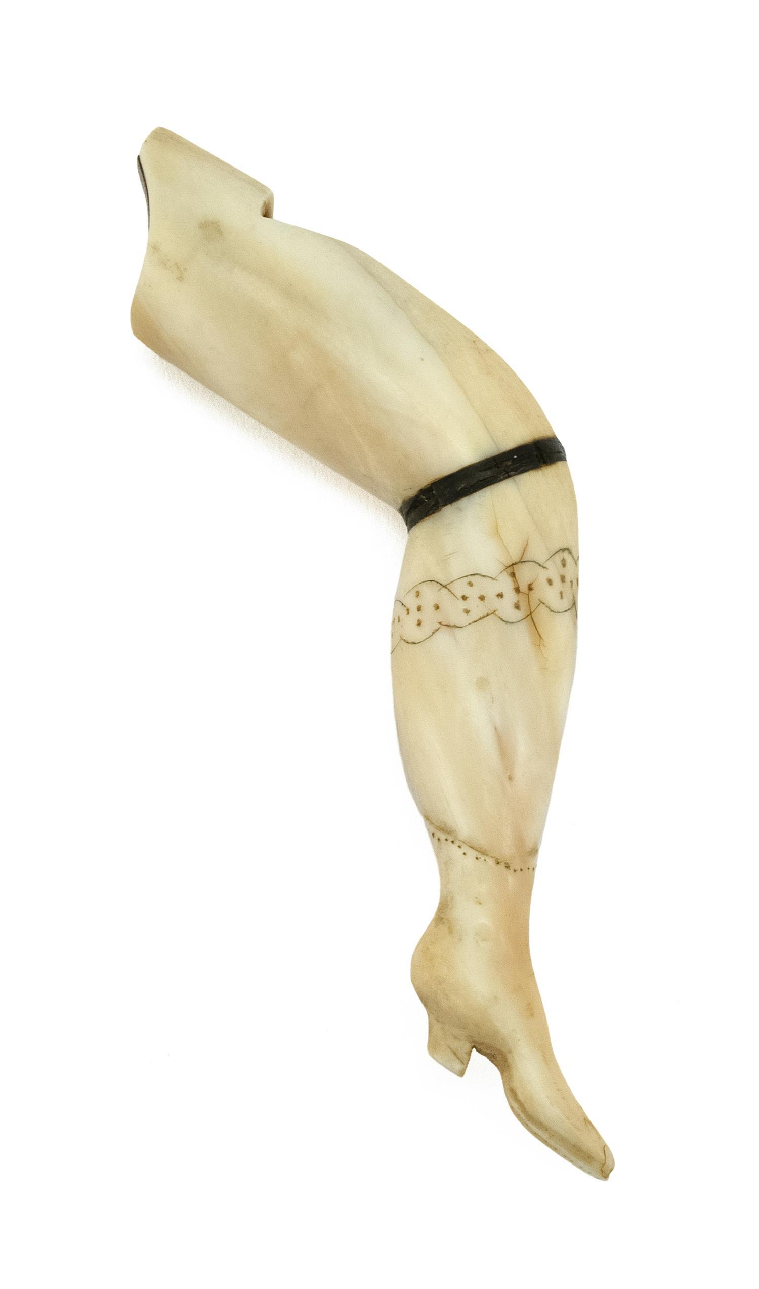 """RARE WHALEMAN-MADE WHALE IVORY """"NAUGHTY LEG"""" WHISTLE Finely detailed engraved garter and carved and engraved boot. Whistle hole at t..."""
