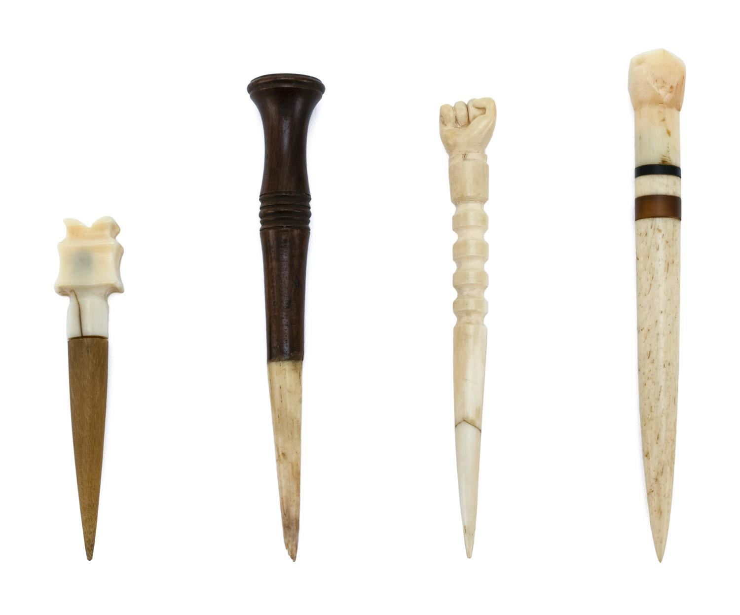 FOUR WOOD, WHALEBONE, HORN AND WHALE IVORY BODKINS One with clenched fist finial, one with faceted finial, one with turned wood fini...