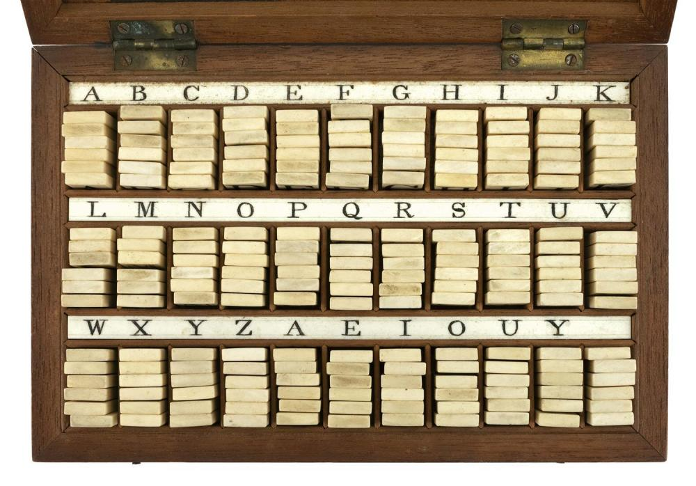 RARE CASED ALPHABET SET Complete set of whalebone tiles, with six tiles for each letter and additional vowel tiles and blanks. Tiles...