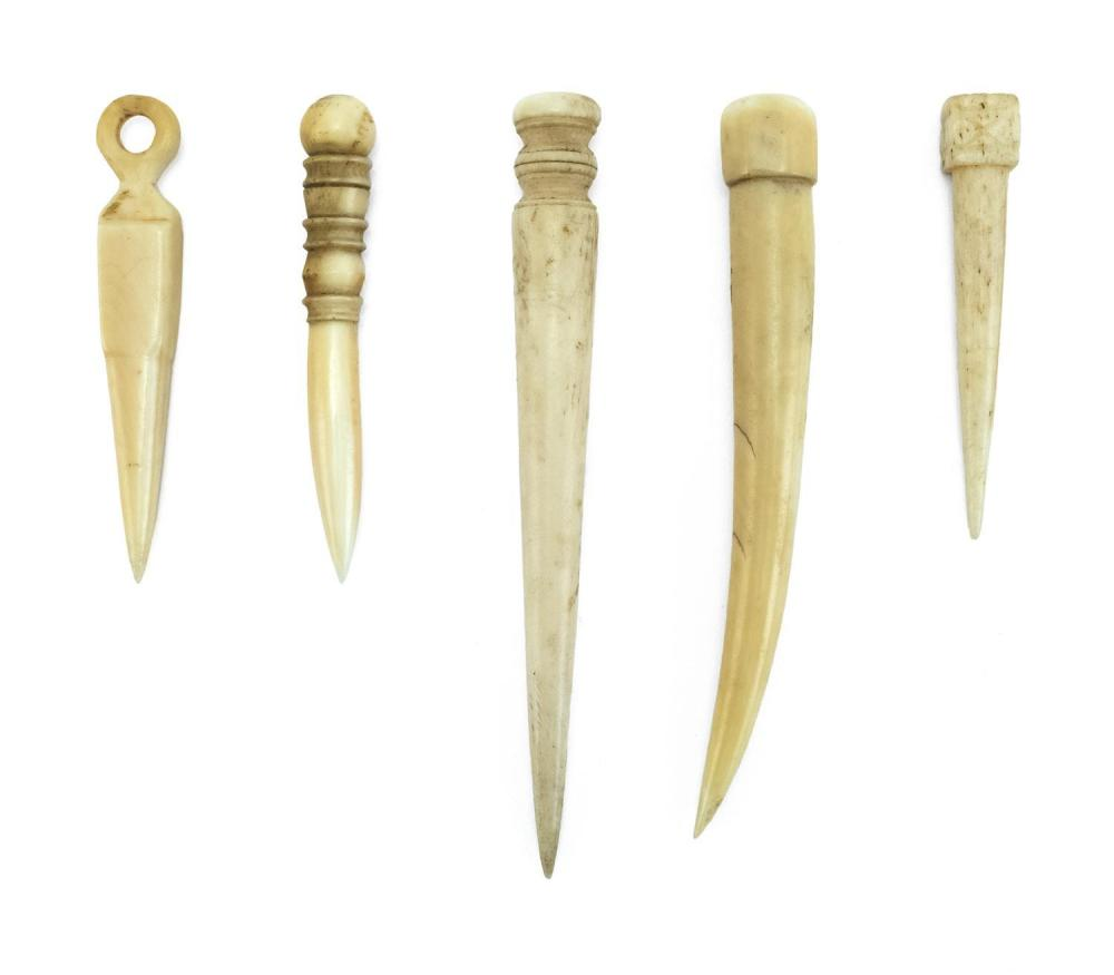 """FIVE WHALEBONE AND WHALE IVORY BODKINS In varied forms. One with inset mother-of-pearl disc at end. Lengths from 2.75"""" to 4.75"""". Fro..."""