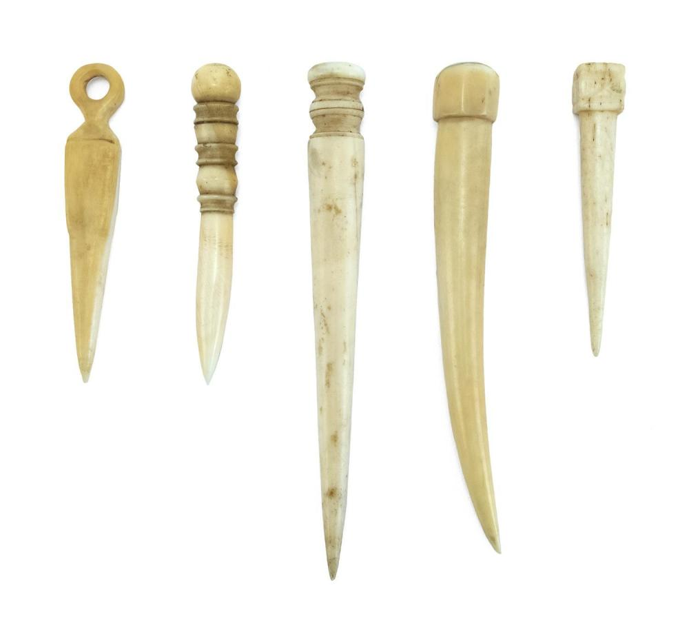 FIVE WHALEBONE AND WHALE IVORY BODKINS In varied forms. One with inset mother-of-pearl disc at end. Lengths from 2.75