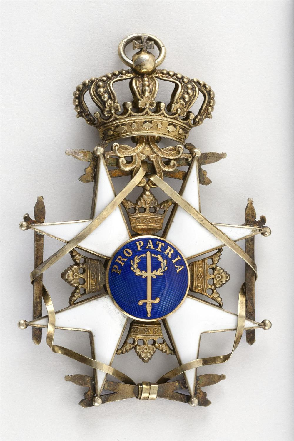 """SWEDISH ORDER OF THE SWORD BADGE Gilt silver and enamel. French swan guarantee mark. Length 3""""."""