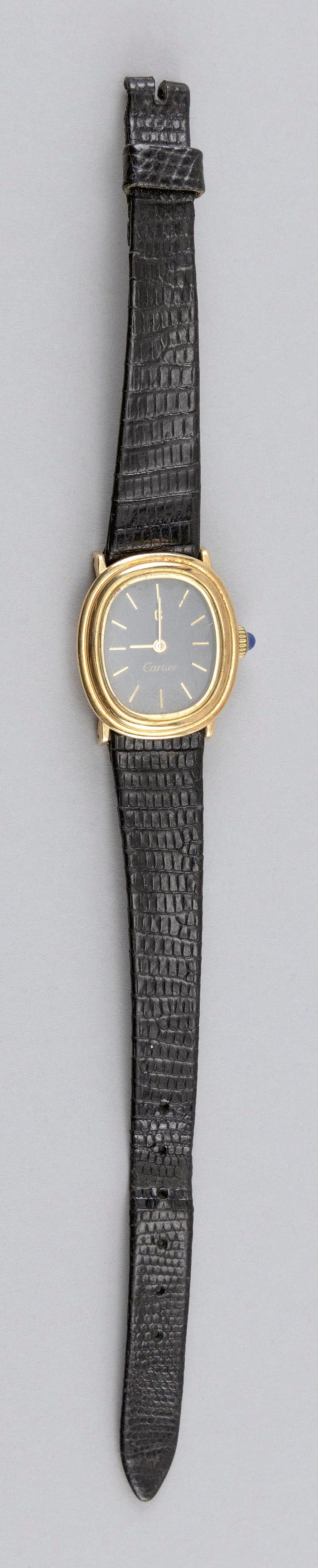 """VINTAGE CARTIER 14KT GOLD LADY'S WRIST WATCH Case numbered 2033453 305409. Black dial with sticks and a """"C"""" at twelve o'clock. Ovoid."""