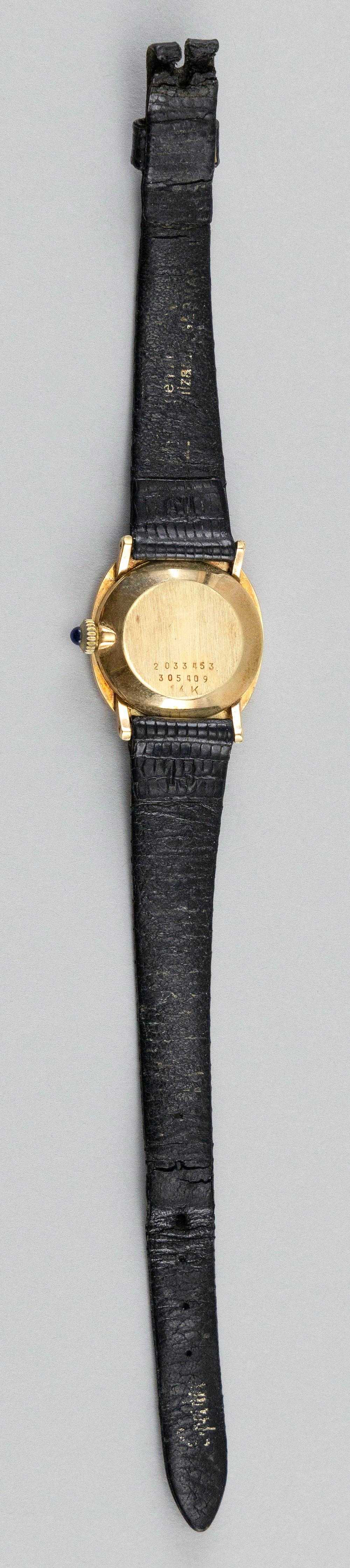 VINTAGE CARTIER 14KT GOLD LADY'S WRIST WATCH Case numbered 2033453 305409. Black dial with sticks and a