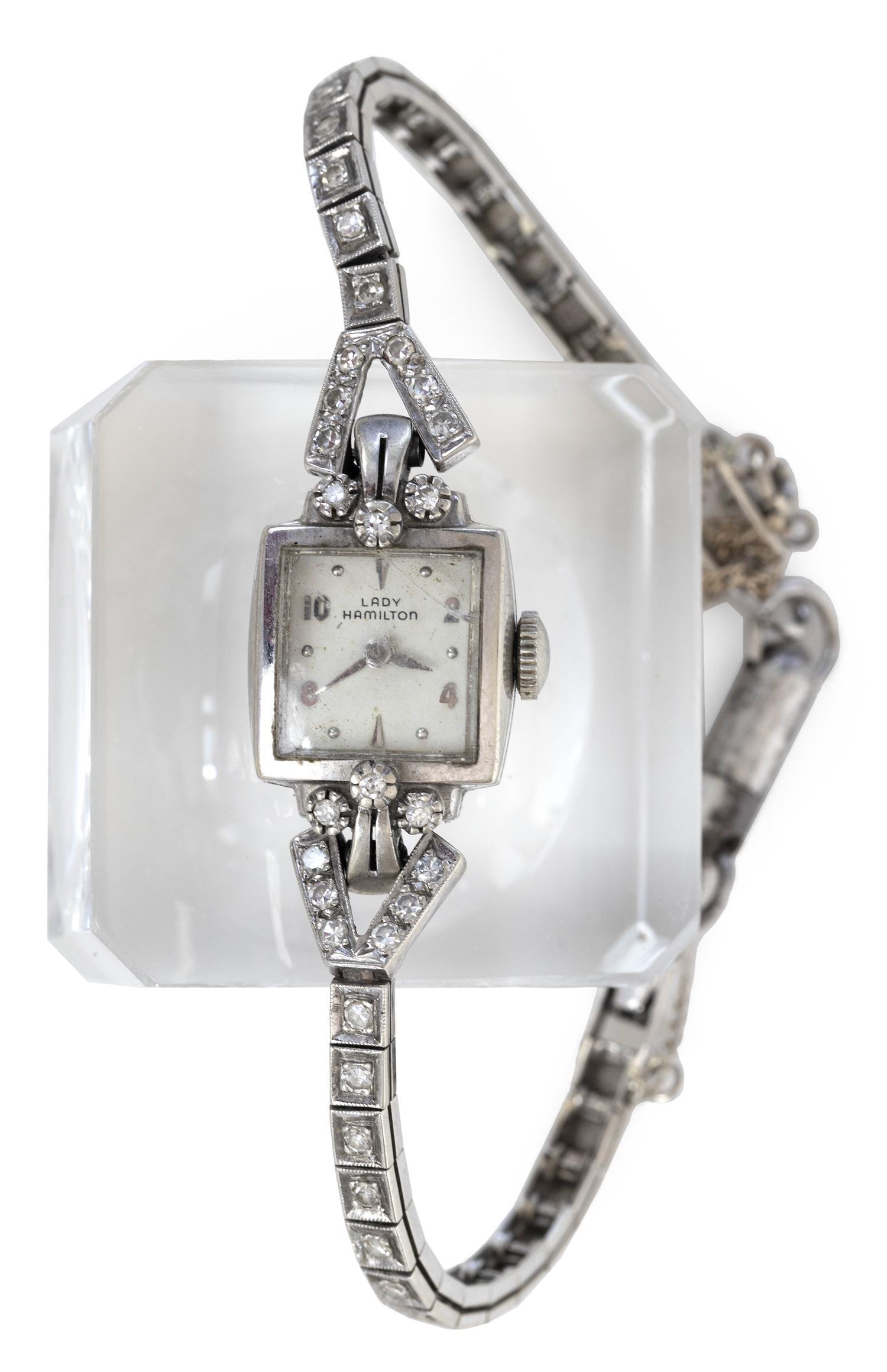 HAMILTON 14KT WHITE GOLD AND DIAMOND LADY'S WRIST WATCH Square case. Lugs and bracelet set with 32 small diamonds.