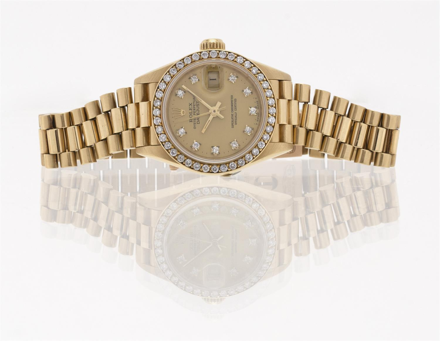ROLEX OYSTER PERPETUAL DATEJUST 18KT GOLD AND DIAMOND LADY'S WRIST WATCH Gold-tone dial with date function and diamond sticks. Case...