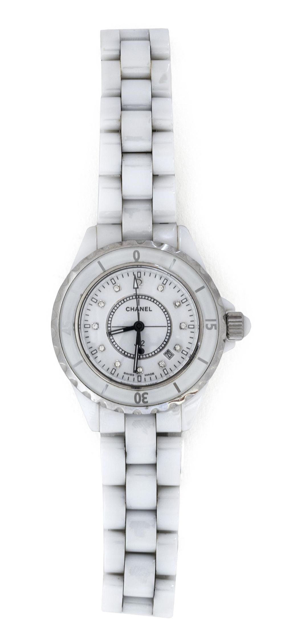 CHANEL WHITE CERAMIC, STEEL AND DIAMOND J12 LADY'S WRIST WATCH Numbered D. M. 82050. Quartz movement. Dial with diamond sticks and d..