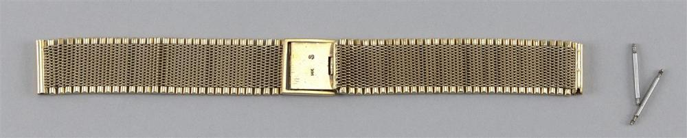 14KT GOLD WATCH BRACELET Mesh with cylindrical edges. Length 6.5