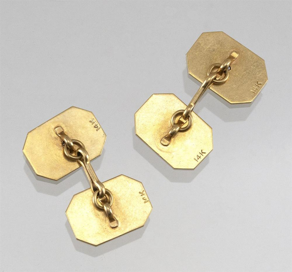 PAIR OF 14KT GOLD AND DIAMOND CUFF LINKS Octagonal, with reeded faces and two small bezel-set diamonds.Approx. 5.12 total dwt.