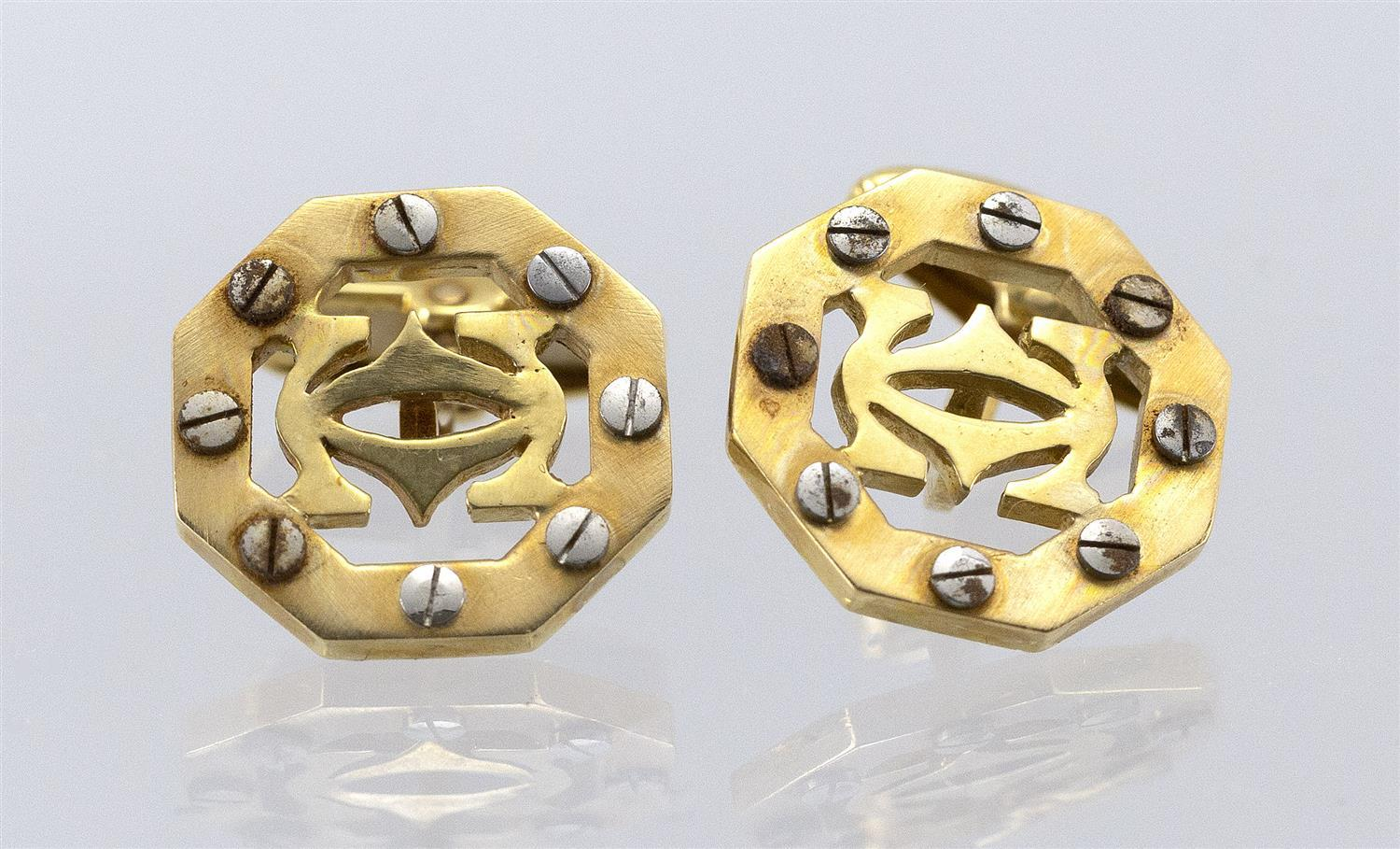 PAIR OF CARTIER-STYLE 18KT GOLD AND STAINLESS STEEL CUFF LINKS Octagonal, with interlocking Cs framed by nail heads. Marked only for...