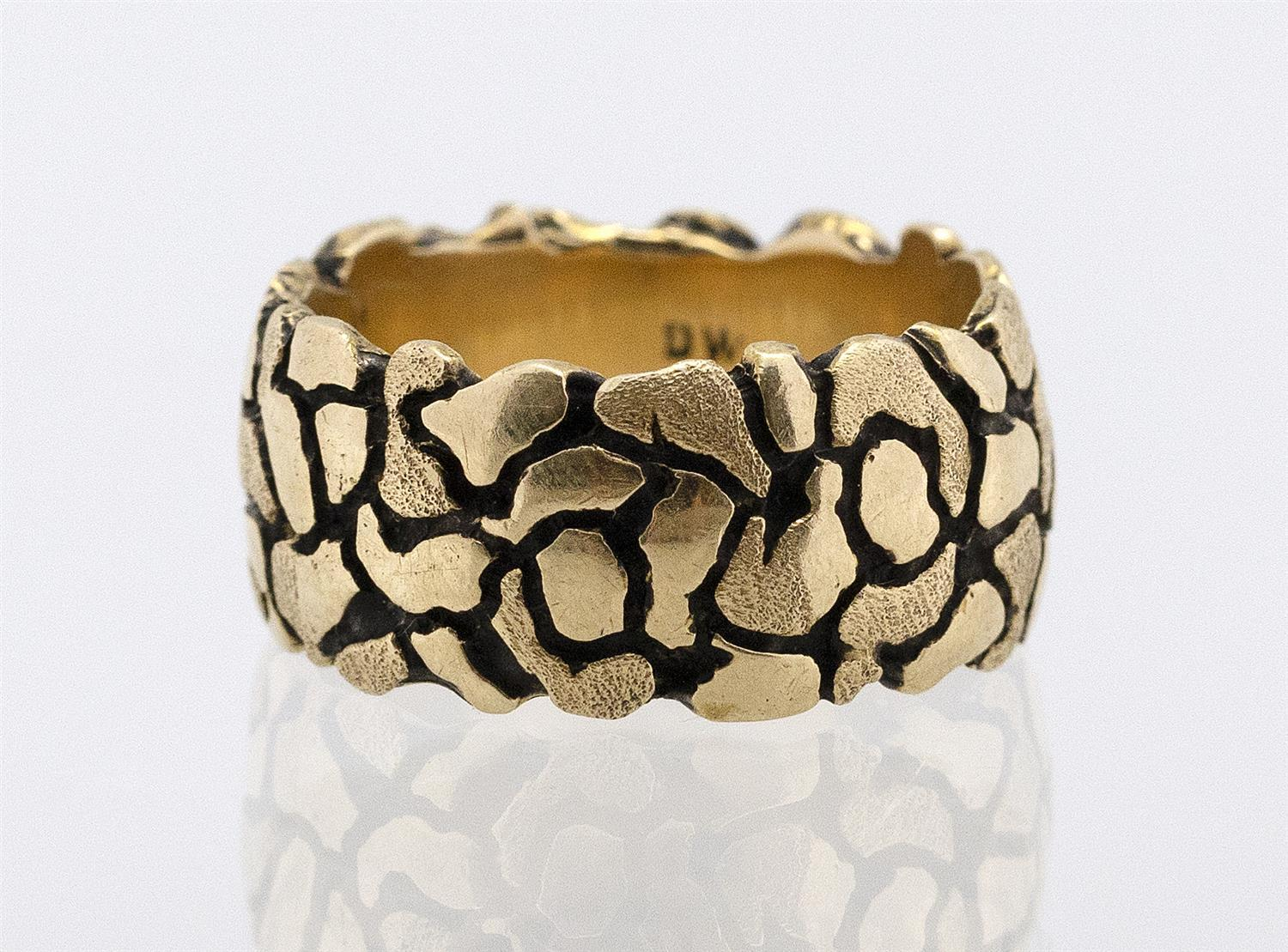 """14KT GOLD MAN'S RING Textured and oxidized surface. Maker's mark """"DW"""". Size 9½.Approx. 8.33 dwt."""