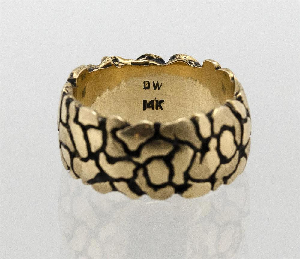 14KT GOLD MAN'S RING Textured and oxidized surface. Maker's mark