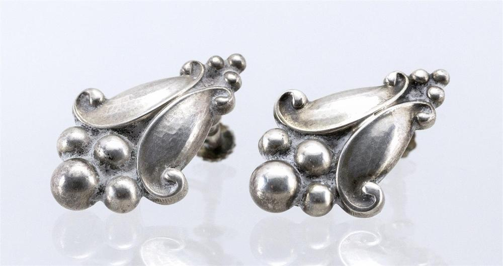 """PAIR OF GEORG JENSEN STERLING SILVER EARRINGS Numbered 32B. Formed as leaves and berries. Hammered finish. Screw backs. Lengths 1"""".A..."""