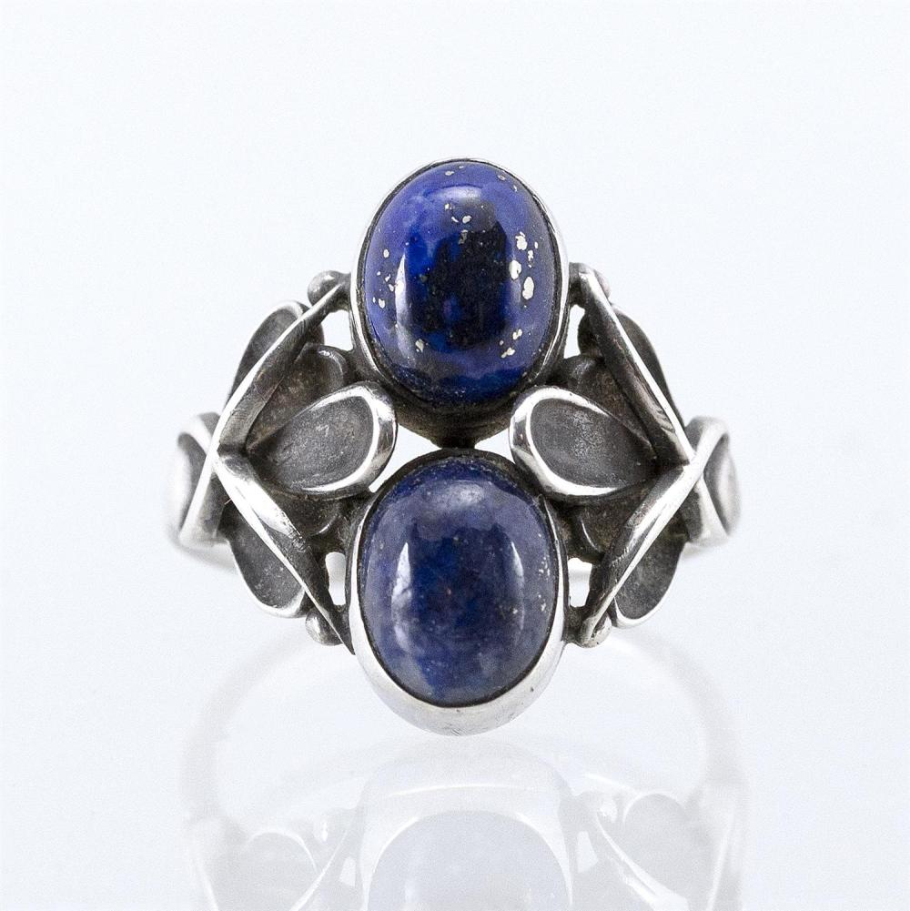 GEORG JENSEN STERLING SILVER AND LAPIS LAZULI RING Two stacked cabochons in a foliate setting. Size 6¾.