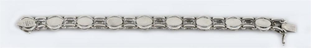 GEORG JENSEN STERLING SILVER BRACELET Numbered 10. Formed as nine framed cabochons joined by two rows of links. Length 7