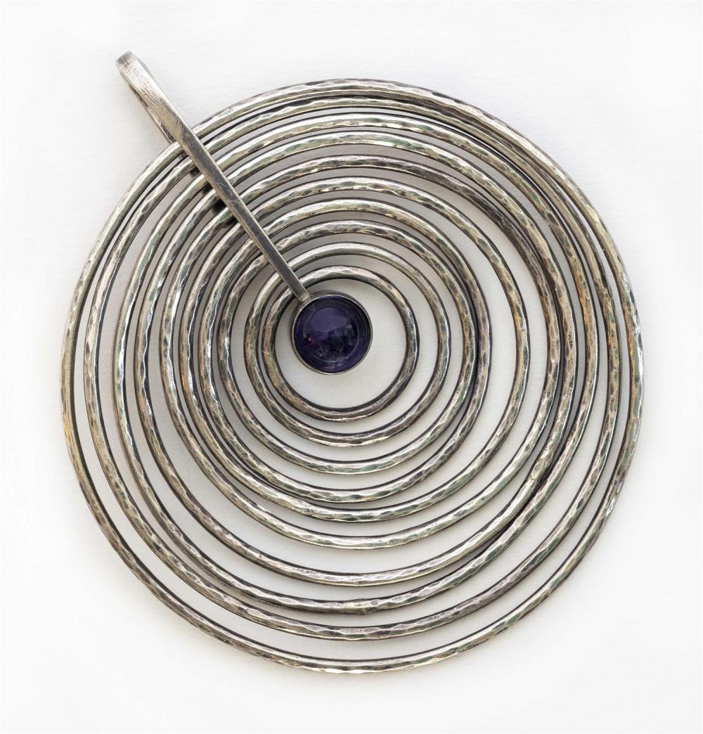 BENT GABRIELSEN FOR GEORG JENSEN STERLING SILVER AND AMETHYST KINETIC PENDANT Formed as ten concentric circles centering a cabochon...