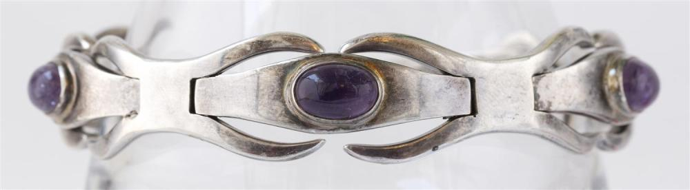 ERIKA HULT DE CORRAL MODERNIST STERLING SILVER AND AMETHYST BRACELET Links alternate between X-forms and oval cabochons. Signed