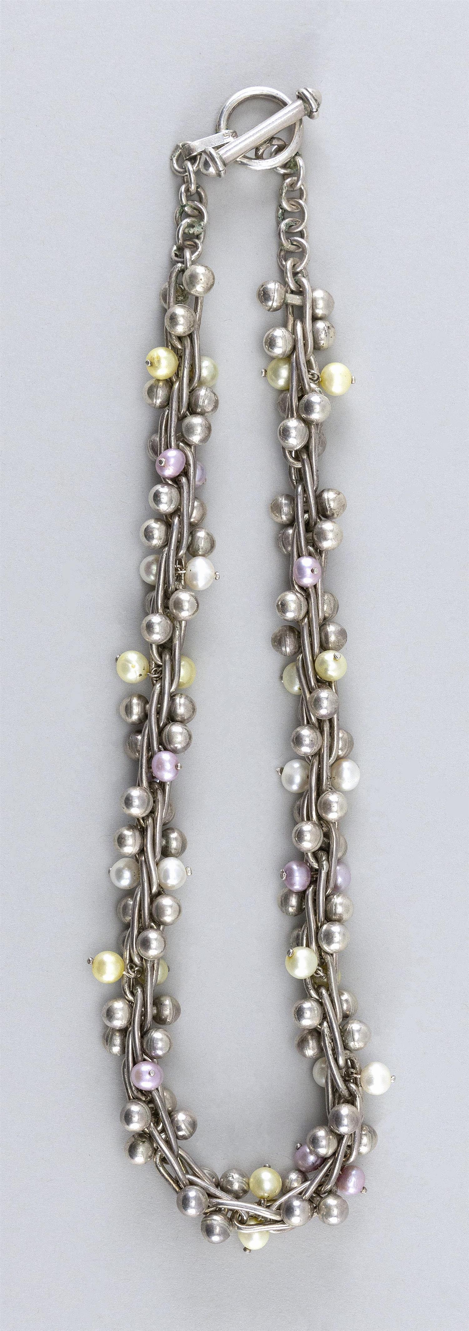 STERLING SILVER AND PEARL CHOKER Silver balls, and pink and white pearls intertwined within silver links. Toggle closure. Clasp mark...