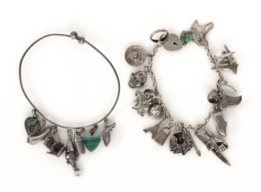 """TWO VINTAGE STERLING SILVER CHARM BRACELETS 1) With seventeen charms and a heart-form locket clasp. Length 7"""". 2) Unmarked bangle wi..."""