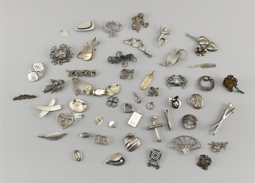 FIFTY-FOUR PIECES OF ASSORTED SILVER JEWELRY Includes 17 pendants, 30 brooches and seven other pieces.Approx. 13.2 troy oz.